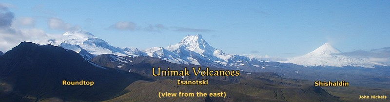 Roundtop, Isanotski & Shishaldin Volcanoes on Unimak Island, viewed from the east.